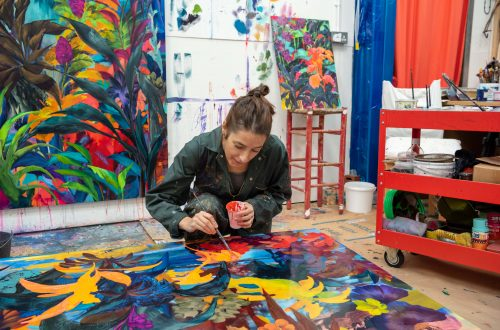 The artist Orlanda Broom painting in her studio.