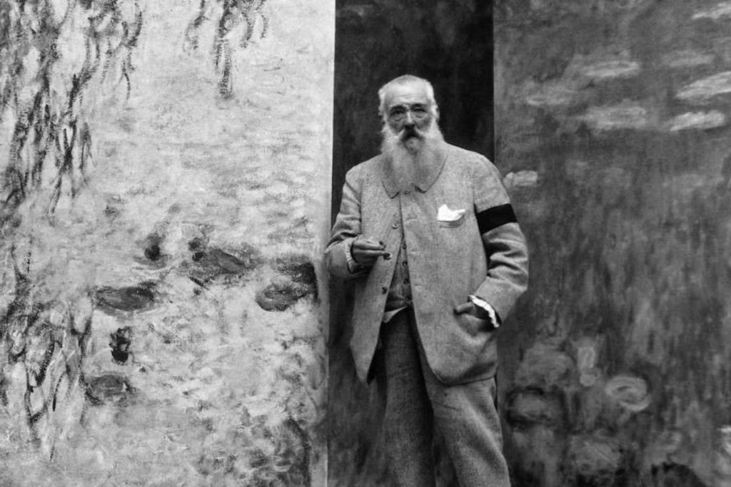 Monet in front of his famed Water Lily series.