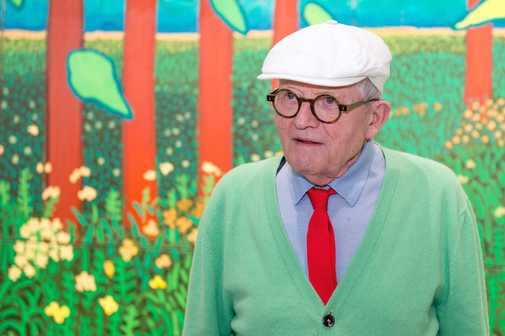 David Hockney in front of his painting The Arrival Of Spring in Woldgate, East Yorkshire in 2011 at Centre Pompidou in 2017. Photo by Aurelien Meunier/Getty Images. a bigger splash.