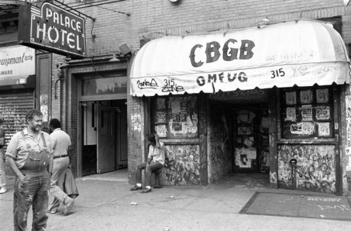 Hilly Kristal (far left) in front of his club, CBGB, 1987 © Ebet Roberts