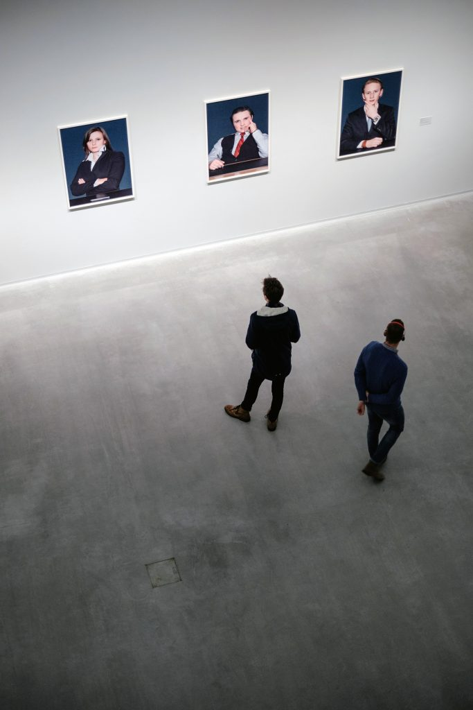 People looking at artworks.