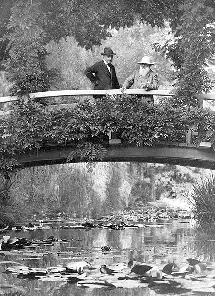 Monet (right) in his garden in Giverny with an unidentified visitor. From The New York Times photo archive, 1922