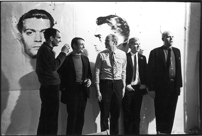 Tom Wesselman, Roy Lichtenstein, James Rosenquist, Andy Warhol and Claes Oldenburg in Warhol's Loft, New York City, 1964. Photograph by Fred W. Mcdarrah.